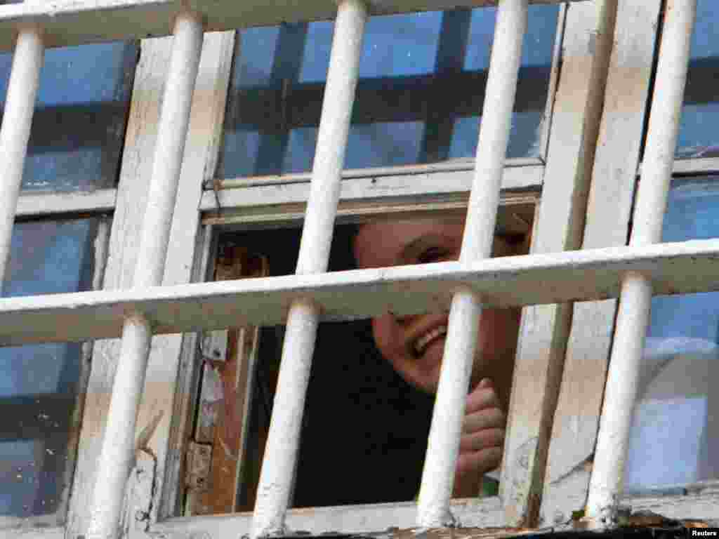 Ukraine's former Prime Minister Yulia Tymoshenko is seen through a prison window in Kyiv. She was recently sentenced to seven years in jail on charges of abuse of office. (Inna Sokolovska for Reuters)
