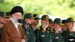 Iran's supreme leader Ayatollah Ali Khamenei (L) speaks during a visit to the Imam Hussein Military College in Tehran, May 20, 2015