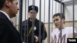 Russia -- Ukrainian Army pilot Nadia Savchenko stands in a cage.