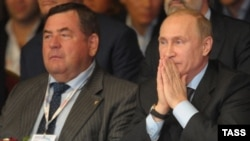 Duma deputy Vasily Shestakov (left) with President Vladimir Putin in 2013
