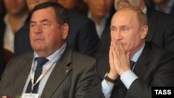 Duma deputy Vasily Shestakov (left) with President Vladimir Putin in 2013