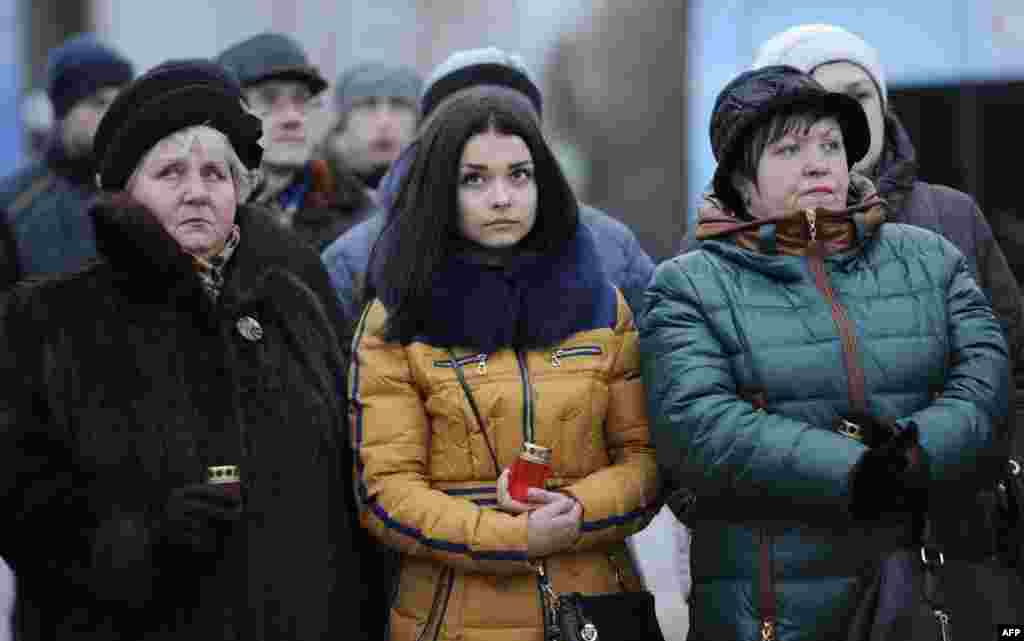 Residents of the self-proclaimed Donetsk People's Republic take part in a vigil for children killed in the conflict in Donetsk. The vigil took place after a young girl was accidentally killed by a Ukrainian armored vehicle in the Ukrainian-held town of Konstantinovka, sparking riots there. (AFP/Aleksandr Gayuk)