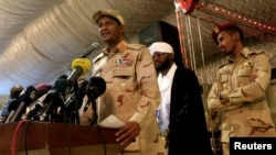 FILE PHOTO: General Mohamed Hamdan Dagalo, head of the Rapid Support Forces (RSF) and deputy head of the Transitional Military Council (TMC) delivers an address after the Ramadan prayers and Iftar organized by Sultan of Darfur Ahmed Hussain in Khartoum, S
