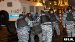 Riot police, with a shiny new truck, breaking up a demonstration against election falsification in Moscow in October.