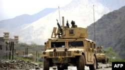 A U.S. Army humvee patrols in Nuristan Province in April 2009, after coalition forces pulled back from outlying bases there.