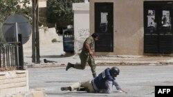 Дамаскідегі қақтығыстардың бірінен көрініс. Сирия, 18 қыркүйек 2013 жыл. (Көрнекі сурет)