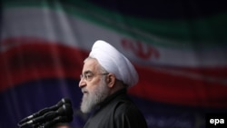 Iran -- Iranian President Hassan Rohani delivers a speech during a ceremony to mark the 38th anniversary of the Islamic revolution, on Azadi Square in Tehran, February 10, 2017
