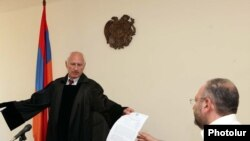 "Armenia - Bagrat Yesayan (R), editor of ""Yerkir"" daily, receives a copy of the court verdict on a libel suit filed by businessman Tigran Arzakantsian, 08Jun2011."