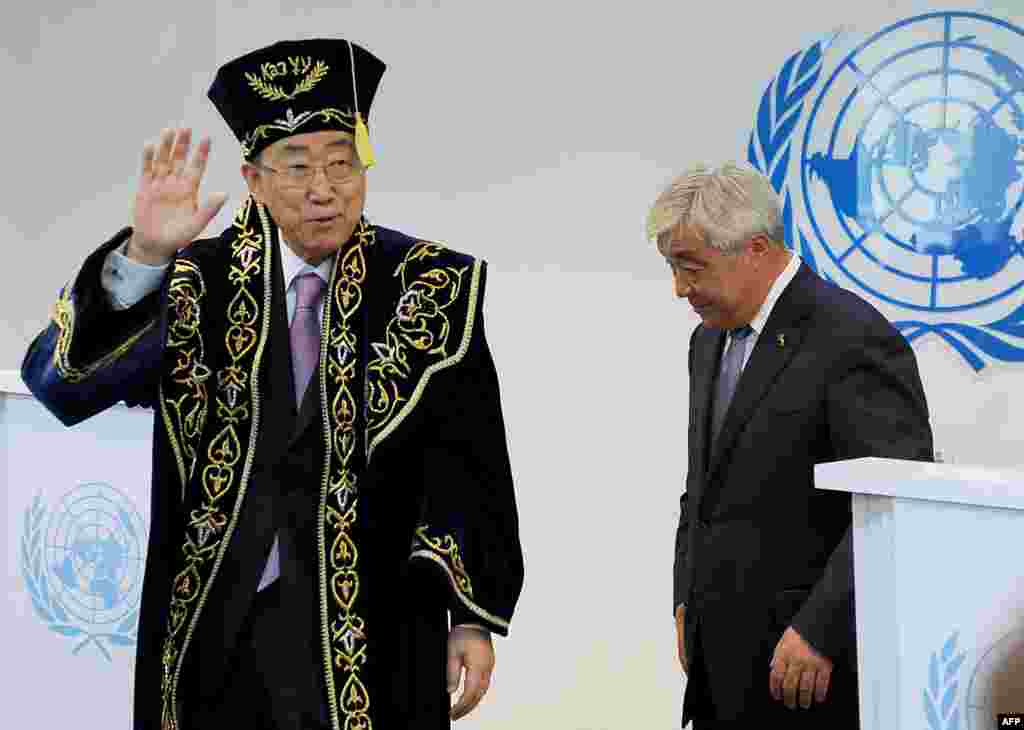 UN Secretary-General Ban Ki-moon (left) wears a traditional Kazakh outfit after he officially opened the organization's new office building in Astana. (AFP/Ilyas Omarov)