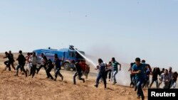 Kobani, etirazçıların qarşıdurması