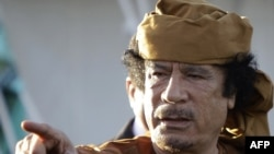 There have been conflicting reports as to how Muammar Qaddafi met his end.