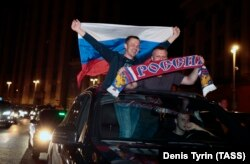 Russian football fans celebrate their team's win over Egypt in central Moscow.