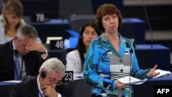 European Union foreign-policy chief Catherine Ashton (right) addresses members of the European Parliament as part of a plenary session in Strasbourg on September 11.