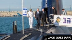 Israeli Prime Minister Benjamin Netanyahu (2nd L) attends a ceremony for the arrival of the German-made INS Rahav, the fifth Israeli Navy submarine, at the military port of Haifa on January 12, 2016. File photo