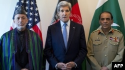 U.S. Secretary of State John Kerry (center) makes a statement before meeting with Afghan President Hamid Karzai (left) and the Pakistani Army chief, General Ashfaq Kayani, in Brussels on April 24.