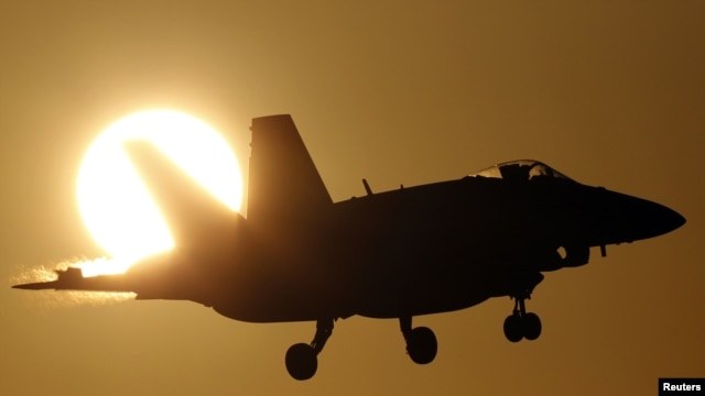 A Canadian CF-18A fighter prepares to land at the Birgi NATO Airbase in Trapani on the southern island of Sicily.