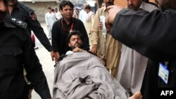 A previous victim of violence against polio-eradication workers is hospitalized in Mardan, Pakistan, in April. There have been more than 10 deaths so far at the hands of militants determined to block polio-vaccination campaigns.