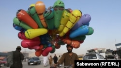 A man sells balloons on the streets of Kabul