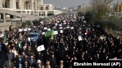 Iranian protesters chant slogans at a rally in Tehran last month.