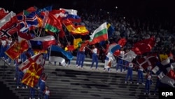 Azerbaijan -- Actors wave the national flags of during the opening ceremony of the First European Games in Baku, Azerbaijan, 12 June 2015.