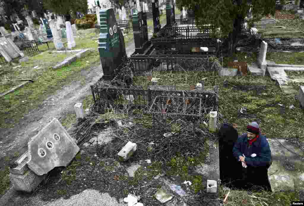 Serbia -- Bratislav Stojanovic, a homeless man, walks out of a tomb where he lives in southern Serbian town of Nis, 09Feb2013