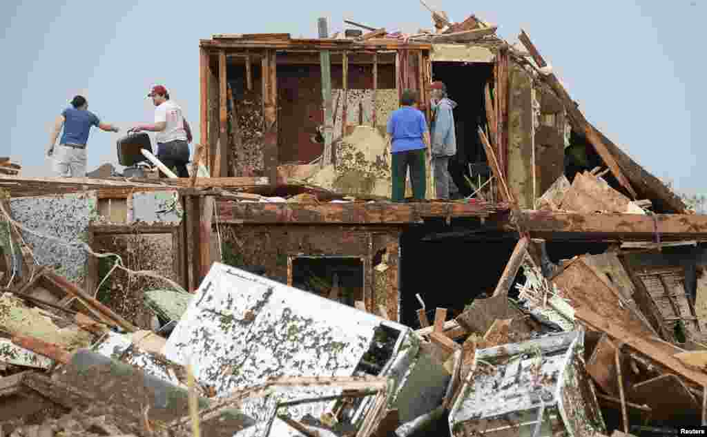 People search for their belongings in the wreckage of their homes.