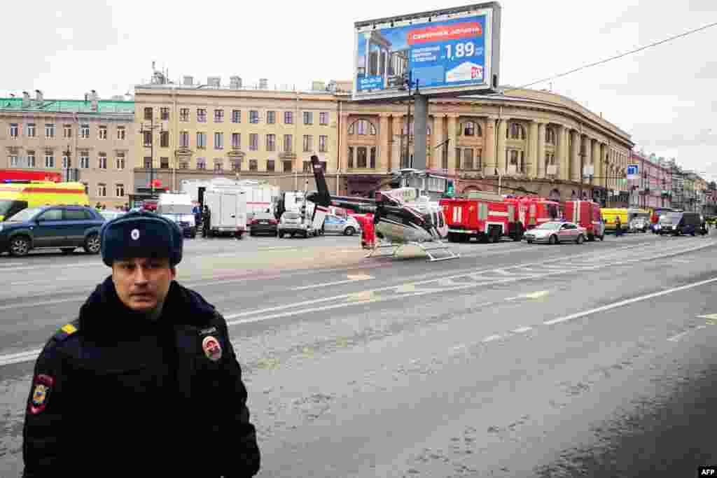 Emergency vehicles and a helicopter seen outside the entrance to St. Petersburg's Tekhnologichesky Institut subway station.