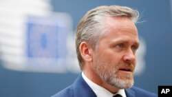 Danish Foreign Minister Anders Samuelsen speaks with the media at the conclusion of an EU-ASEM summit in Brussels, Friday, Oct. 19, 2018. EU leaders met with their Asian counterparts Friday to discuss trade, among other issues. (AP Photo/Alastair Grant)