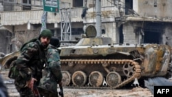 Syrian pro-government forces patrol a district of Aleppo earlier this week.