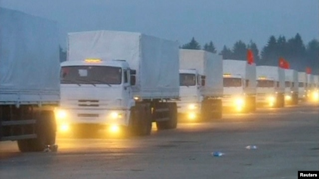 A screen capture of a Russian convoy of trucks that Moscow says is carrying humanitarian aid for Ukraine sets off from near the Russian capital on August 12.