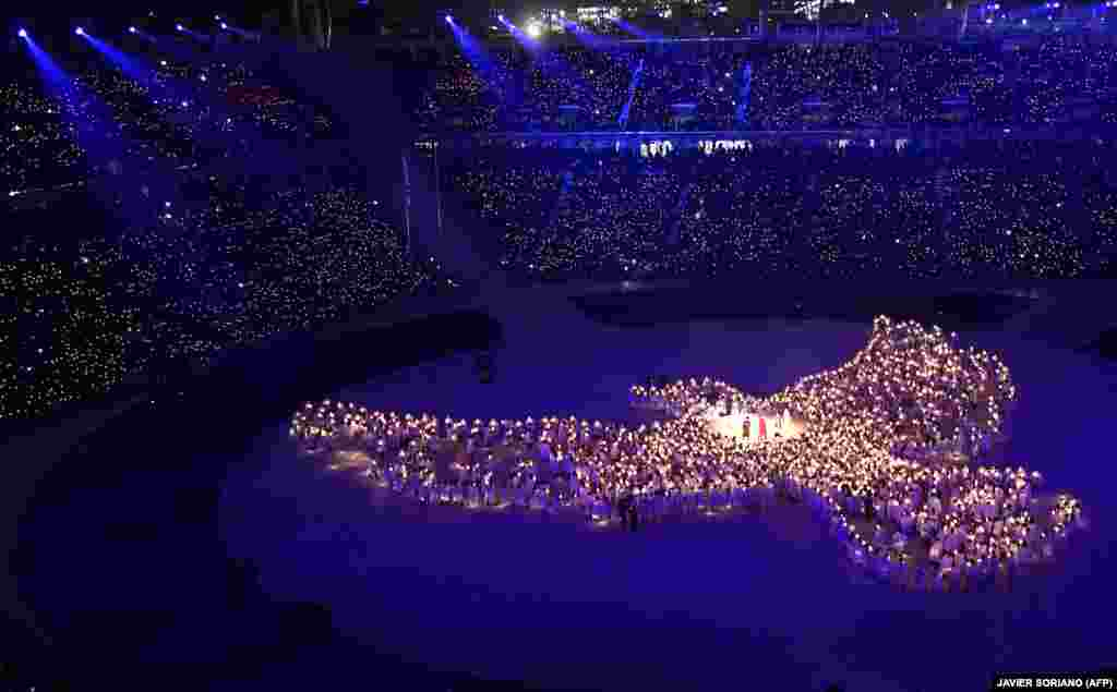 "The IOC President Thomas Bach said the opening ceremony showed unity and harmony with a ""powerful message of peace."""