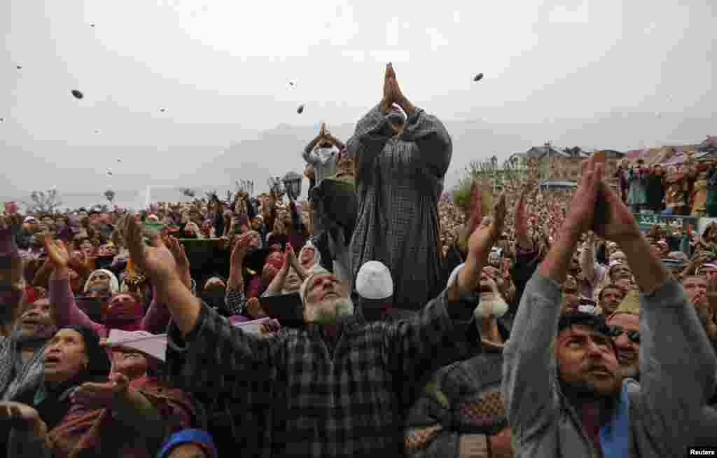 Kashmiri Muslims pray upon seeing a relic believed to be hair from the beard of the Prophet Muhammad during a festival to mark the anniversary of the death of Abu Bakr, one of the companions of the Prophet Mohammad, at the Hazratbal shrine in Srinagar. (Reuters/Danish Ismail)