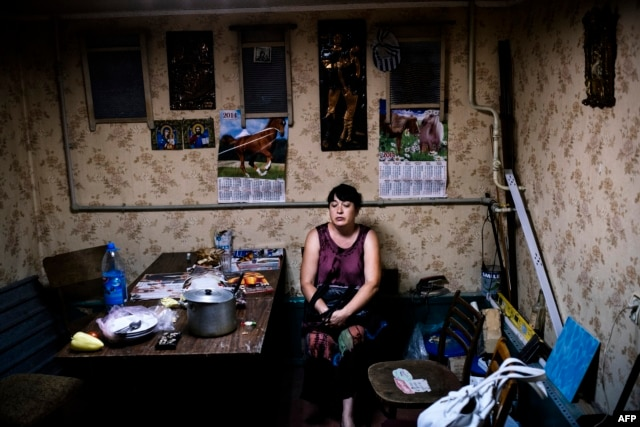 A woman sits inside a makeshift bomb shelter in Donetsk in mid-August.