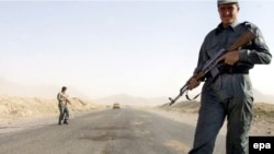 Afghan police guard the Kabul-Kandahar highway