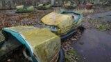 Заброшенный парк аттракционов в городе Припять в 2 км от Чернобыльской АЭС