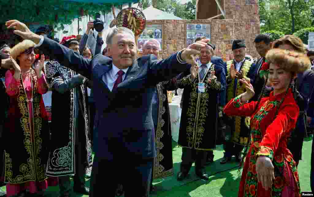 Kazakh President Nursultan Nazarbaev dances with artists during celebrations to mark Kazakhstan People's Unity Day in Almaty on May 1. (Reuters/Shamil Zhumatov)