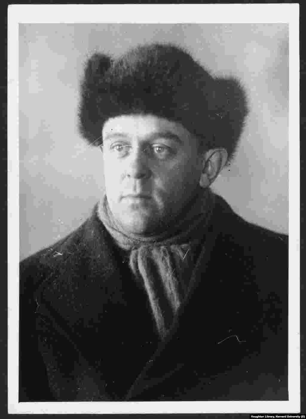 """Reed wearing a fur """"ushanka"""" winter cap during one of his trips to Russia   In April 1918, when Reed and Bryant returned to the United States to write their accounts of the revolution in Russia, Reed was arrested for previously published anti-war articles.  His notes from Russia were confiscated. Eventually the papers were returned and he locked himself away in a Greenwich Village apartment with a Russian dictionary to write his most famous book. The account of what he saw in Russia was called Ten Days That Shook The World. A friend who bumped into Reed at the time described him as """"gaunt, unshaven, greasy-skinned, a stark sleepless half-crazy look on his slightly potato-like face."""""""