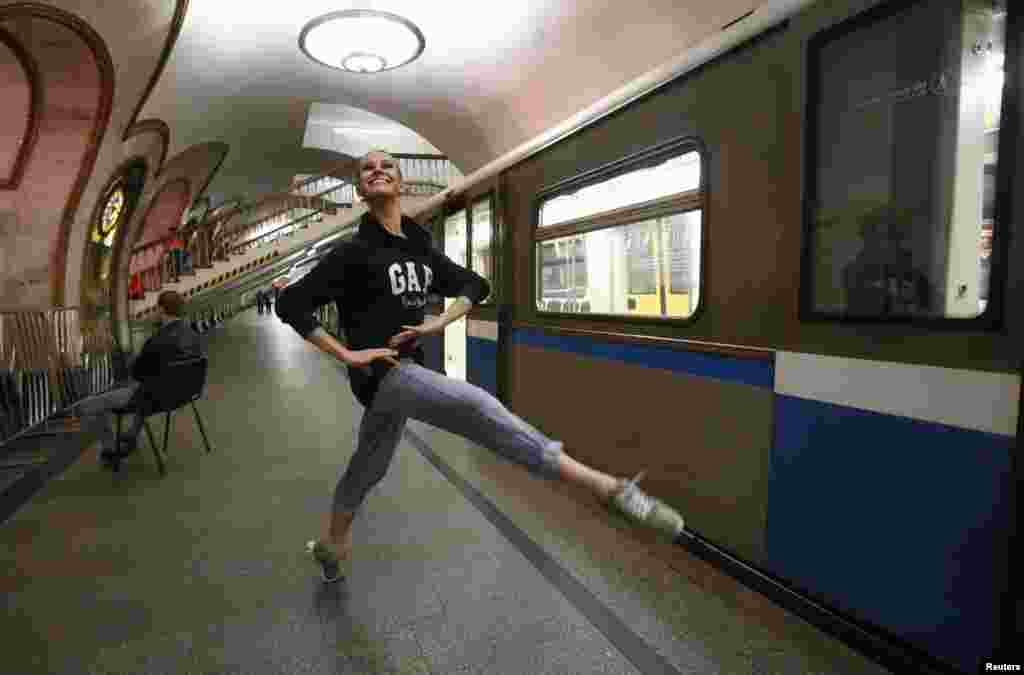 A dancer of the Kremlin Ballet theater warms up before an overnight performance, staged to coincide with the ongoing FIFA Confederations Cup Russia 2017, at Novoslobodskaya subway station in Moscow, on June 26. (Reuters/Sergei Karpukhin)