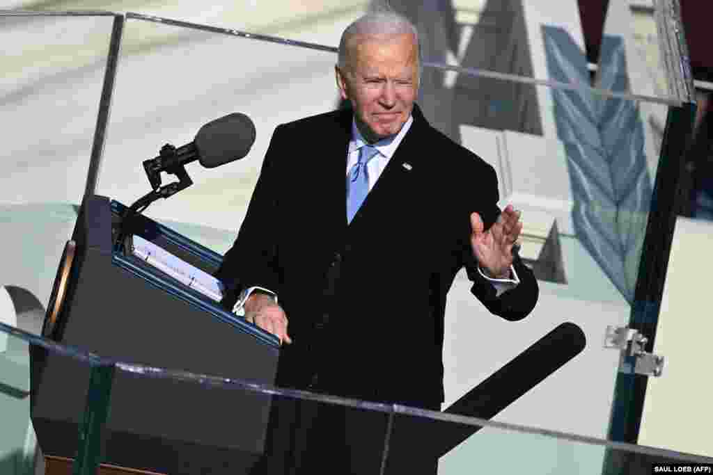 U.S. President Joe Biden gestures as he delivers his inauguration speech on January 20, 2021, at the U.S. Capitol in Washington, DC.(Photo by SAUL LOEB / POOL / AFP)