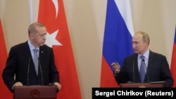 Russian President Vladimir Putin (R) and Turkish President Recep Tayyip Erdogan (L) attend a joint news conference following Russian-Turkish talks in the Black sea resort of Sochi, Russia, October 22, 2019