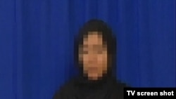 This unidentified woman, described as an arrested Tehran protester, was shown confessing to crimes on Iranian state television.