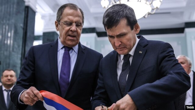 Russian Foreign Minister Sergei Lavrov (left) and Turkmen Foreign Minister Rasit Meredow cut a ribbon during the opening ceremony for new Russian Embassy buildings in Ashgabat on January 27. Lavrov just happened to be in town at the same time as a high-level meeting of Caspian Sea states.