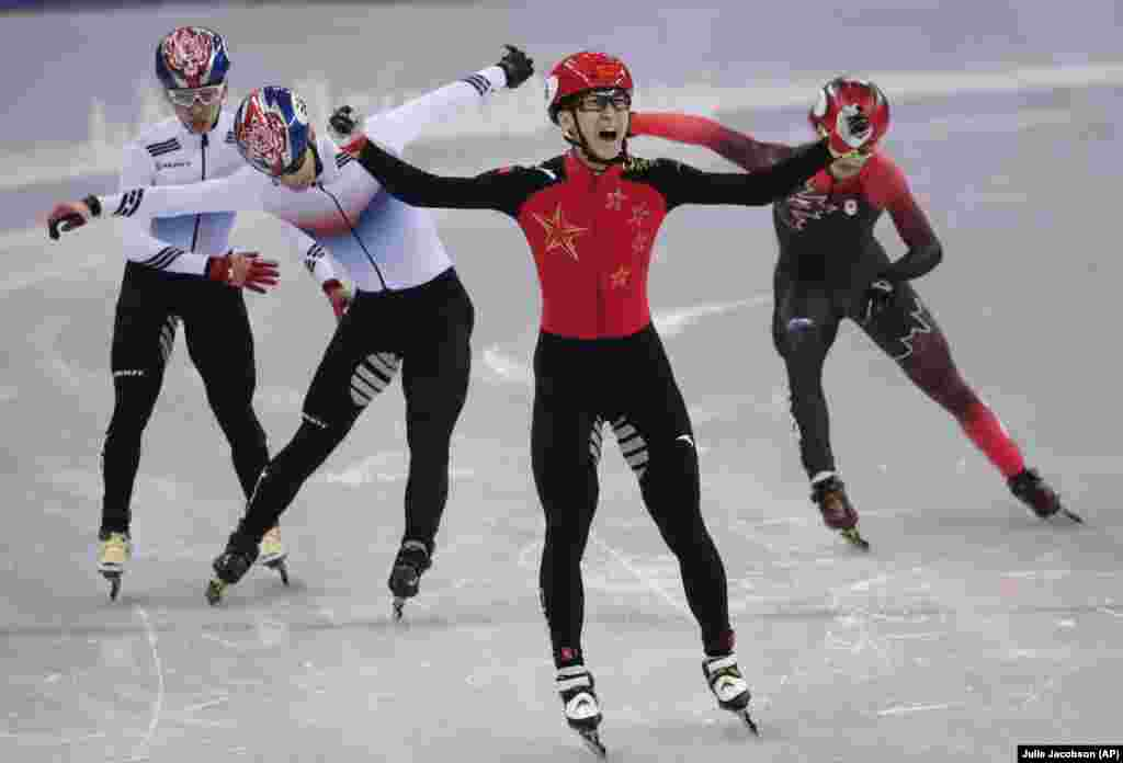 Short Track Speed Skating: Wu Dajing of China celebrates after winning the men's 500 meters short track speedskating A final in the Gangneung Ice Arena at the 2018 Winter Olympics in Gangneung, South Korea, February 22, 2018.