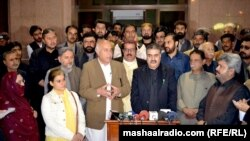 FILE: Nawab Sanaullah Zehri (C) surrounded by Balochistan lawmakers.