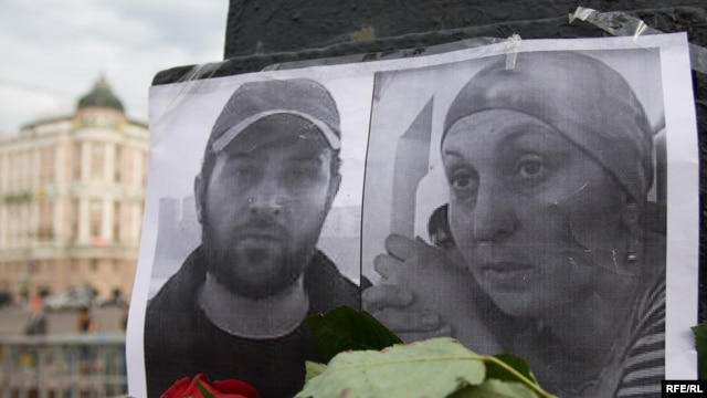 A makeshift memorial to Alik Dzhabrailov and Zarema Sadulayeva of the Save The Generations charity, murdered in Chechnya last month