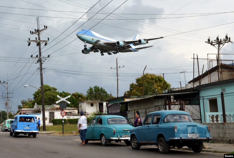 "When U.S. President Barack Obama made his historic visit to Cuba in March, Reuters photographer Alberto Reyes knew exactly where he needed to be.   He writes that ""a motorcyclist from the neighborhood, who had been hired by Reuters, showed me the spot where it would be possible to see the plane if it came in from that angle.""   ""I knew the exact spot when I saw the White House advance planes coming in before Air Force One. There were a lot of people on the street waiting for the plane. It was an important moment for many. One neighbor shouted out to me that the plane was coming in before I could hear the turbines. ""The neighbor who was shouting, the clamor of the people, the roar of the plane's engines, the sheer size of it so close to the houses, and the brief moments I had to take this picture, made this moment unforgettable to me."""
