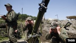 Artillery practice at Ingur frontier post, where Russian border guards have been deployed to defend Abkhazia's border with Georgia