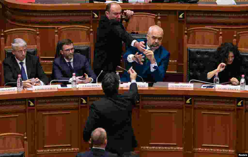 Albanian Prime Minister Edi Rama reacts as ink is thrown at him by members of the opposition during a parliamentary session in Tirana. (Reuters/Stringer)