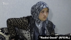 Nilufar Rajabova says that one of the arresting officers threatened to rape her.