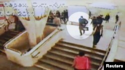 Footage from CCTV cameras shows a person, highlighted as a suspected bomber shortly before last week's explosion at Minsk's Oktyabrskaya subway station
